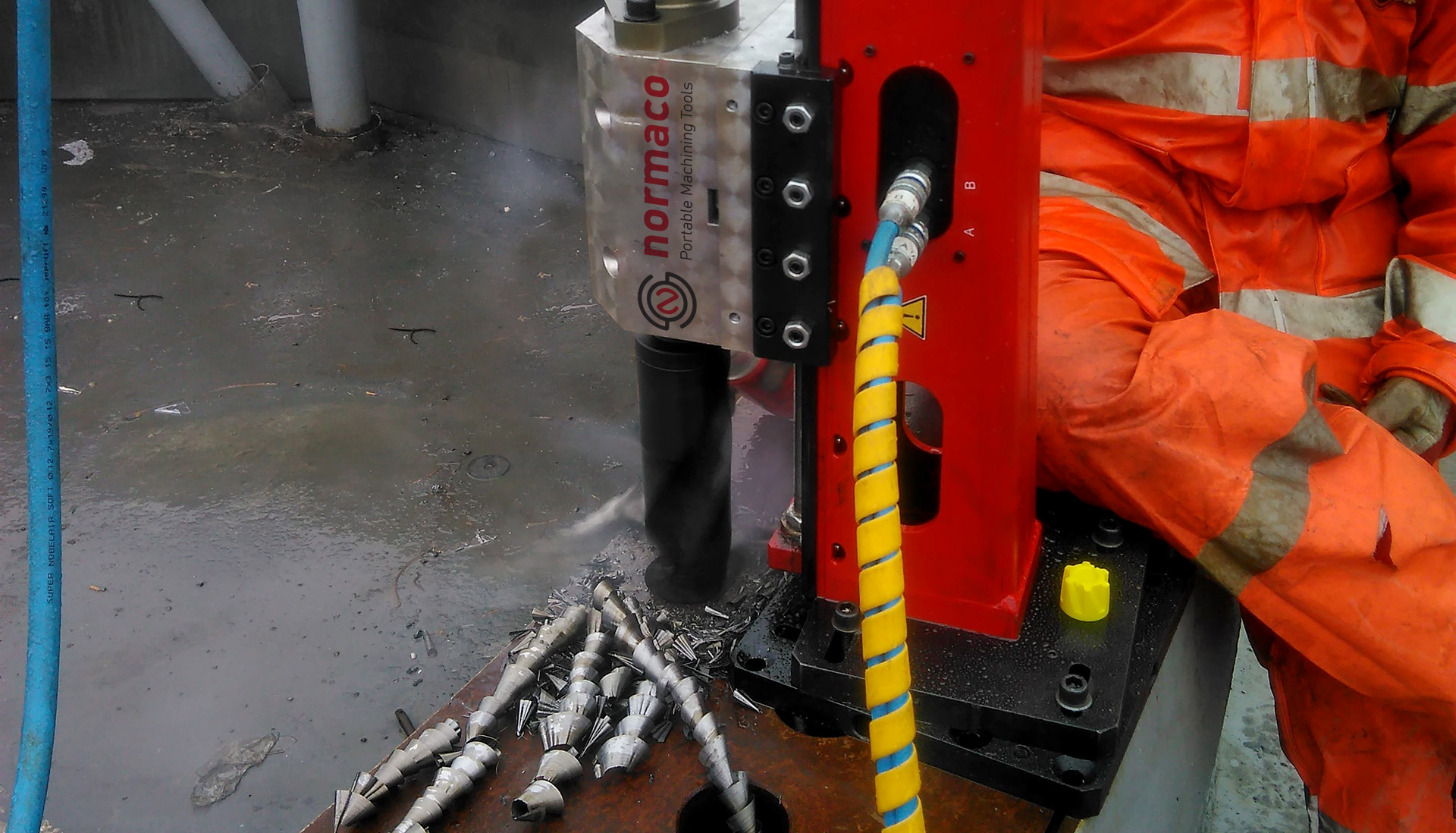 Normaco Portable drill used to drill wind turbine flange
