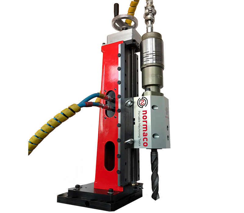 Normaco portable drill with drill bit and base plate