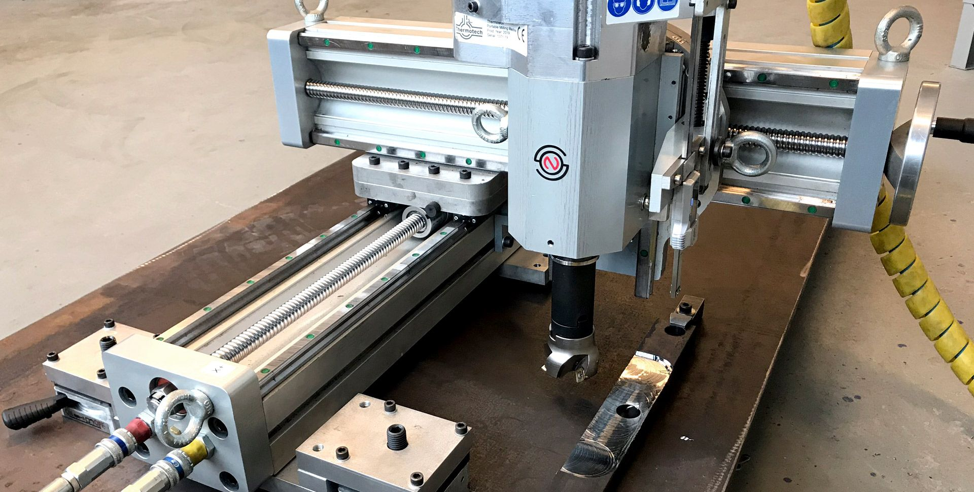 Normaco Lightweight portable milling machine on steel plate